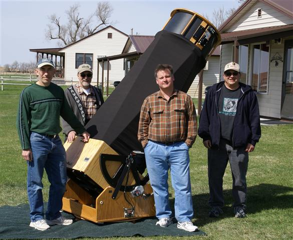 Star Gazers standing with their powerful telescope